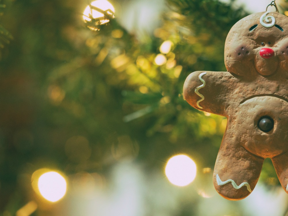 Happy gingerbread man hanging from tree