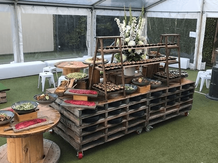 Pallet buffet bench with cable drum beside